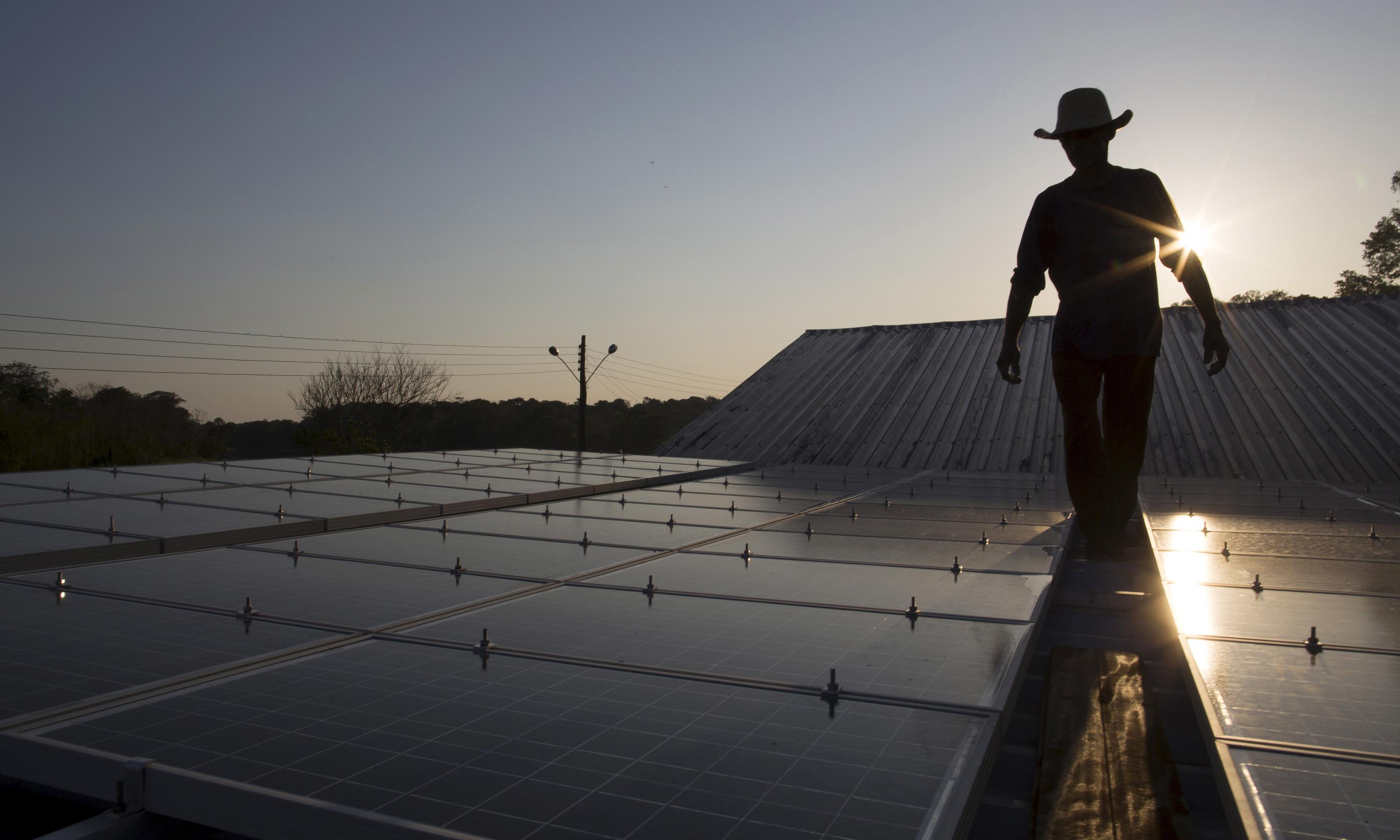 A person with a cowboy hat on solar panels